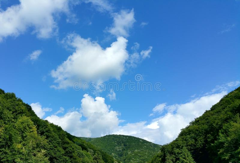Summer landscape. Sky blue clouds mountsins stock photos