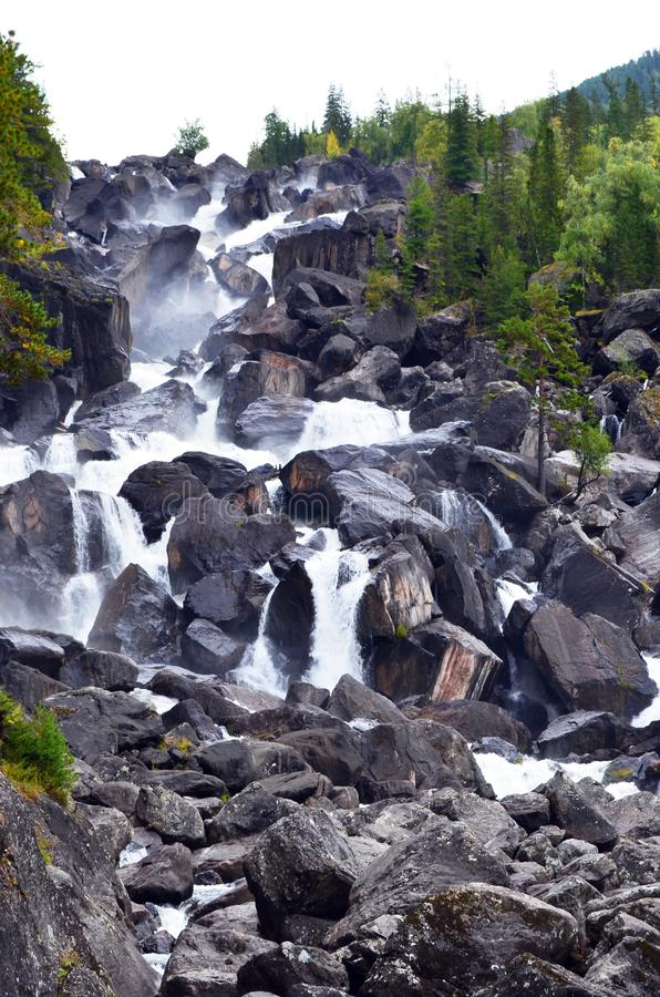 Summer landscape of Uchar waterfall in Altai mountains, Altai Republic, Siberia, Russia royalty free stock photos