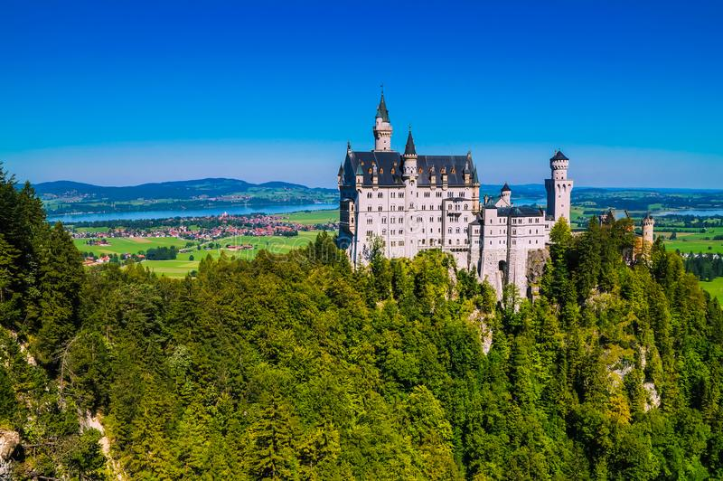 View of the famous tourist attraction in the Bavarian Alps - the 19th century Neuschwanstein castle royalty free stock image