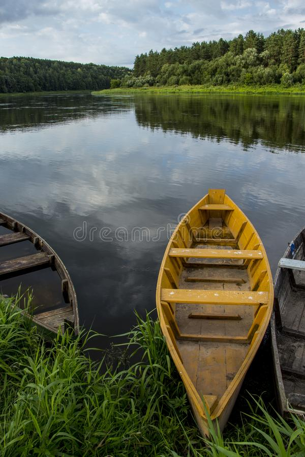Summer landscape with wooden fishing boats by the lake stock photo