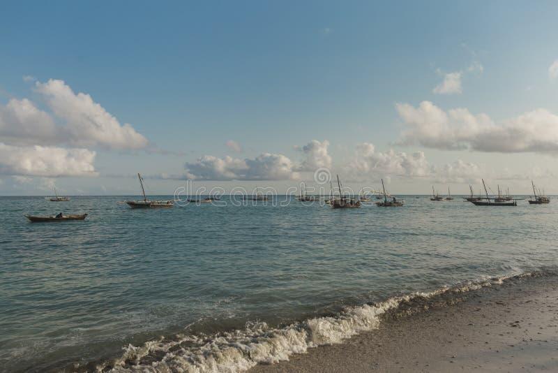 Summer landscape. Wooden old fishing ships sunrise near the shore stock photo