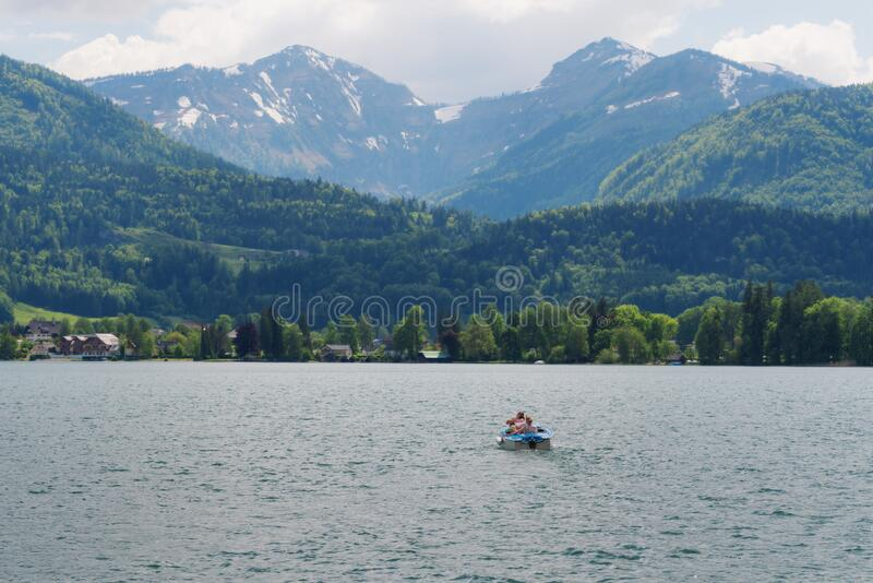 Summer landscaped, family sailing boat in lake with mountain view at Hallstatt, Austria in summer stock photos