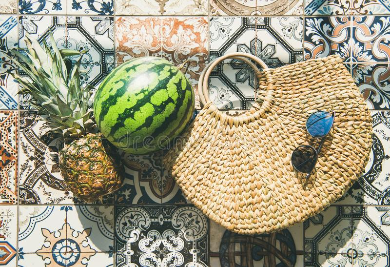 Summer lifestyle background with fruits and straw bag, horizontal composition. Summer lifestyle background. Flat-lay of summer fruit pineapple and watermelon royalty free stock photos