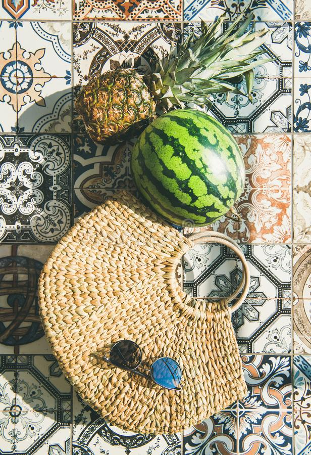 Summer lifestyle background with fruits and straw bag, vertical composition. Summer lifestyle background. Flat-lay of summer fruit pineapple and watermelon stock photography