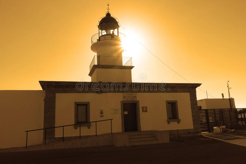 Summer: a lighthouse with sunset light of cape of the Crosses in Spain. Cape of the Crosses Cape de Creus in English Capo delle Croci, in Spanish Cabo de Creus royalty free stock photography