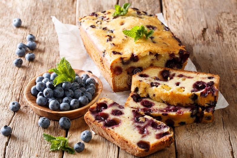 Summer loaf of fresh blueberry muffin bread cake decorated with stock image