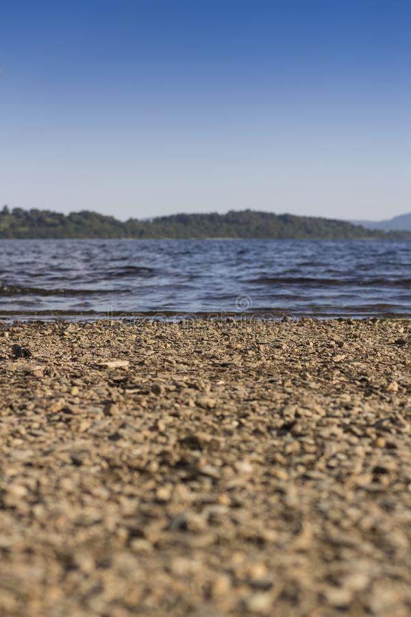 Summer at Loch Lomond beach. Beautiful Loch Lomond beach on a sunny summers day in the Highlands, Scotland stock photos