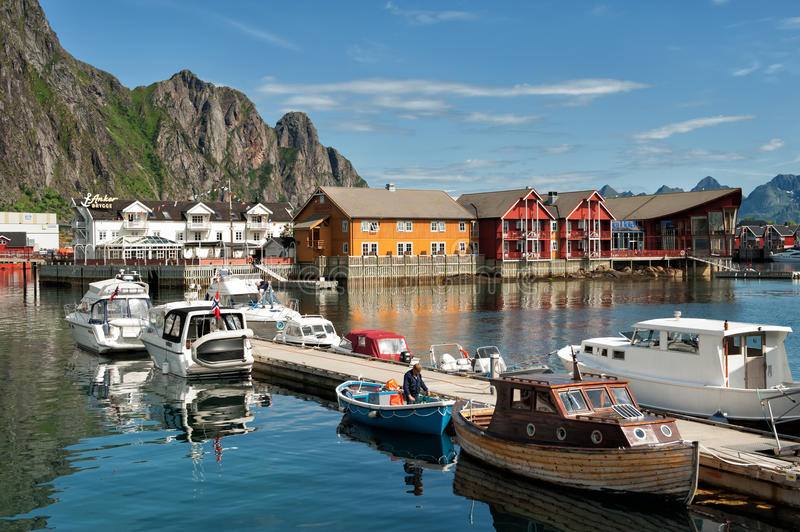Summer in Lofoten. Svolvaer, Norway - July 4, 2011: A man preparing his boat in the leisure boat harbor at Svolvaer on a sunny summers day. Svolvaer is a popular stock images