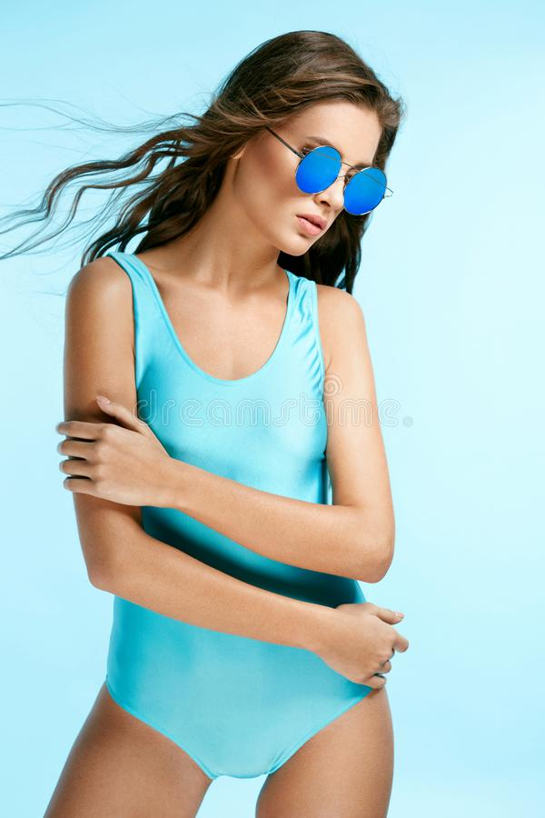 Summer Look. Female Model In Swimsuit And Sunglasses. royalty free stock images