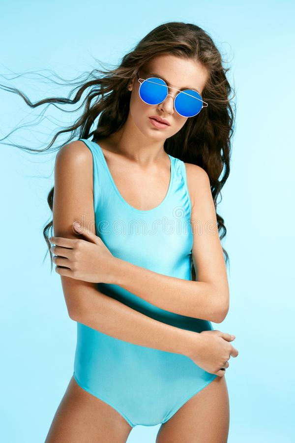 Summer Look. Female Model In Swimsuit And Sunglasses. stock images
