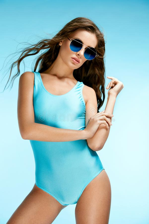 Summer Look. Female Model In Swimsuit And Sunglasses. royalty free stock photography