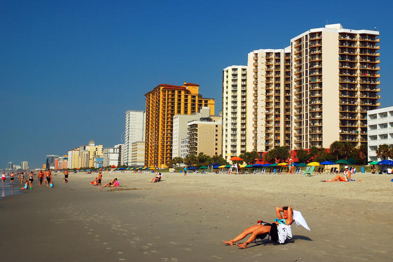 Summer lounging at Myrtle Beach. A Summer Crowd Starts to Form on Myrtle Beach stock images