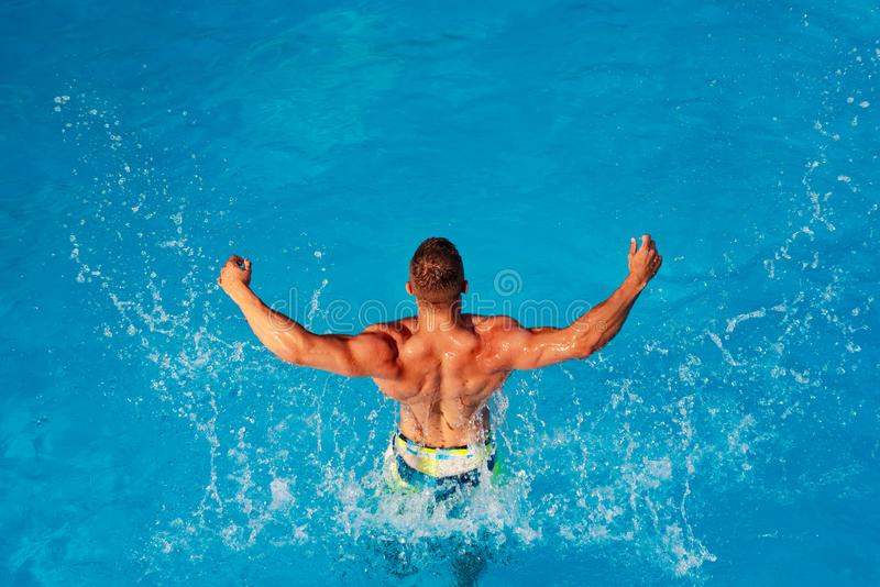 Summer men - excited. luxury swimming pool. Relax in spa swimming pool. Handsome man having fun in summertime. Athletic royalty free stock photos