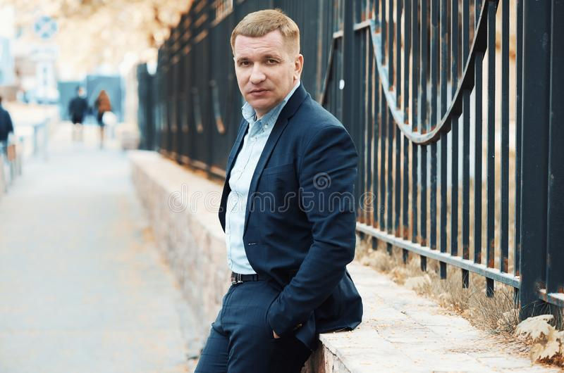 Summer man portrait. Fashionable guy on a city street. Outdoors stock image