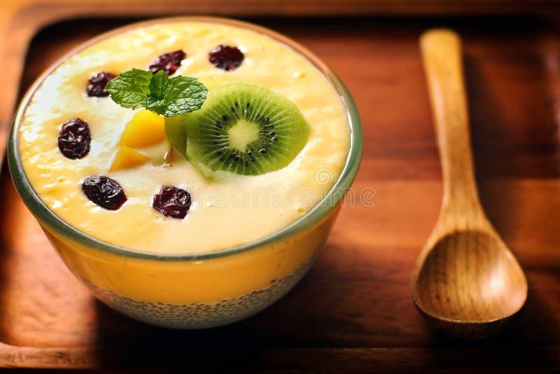 Summer Mango Milk Shake with Chia Seed Pudding. Summer dessert on the beach, mango milk shake with chia seed pudding stock images