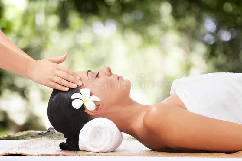 Summer massage. Portrait of young beautiful woman on color back stock images
