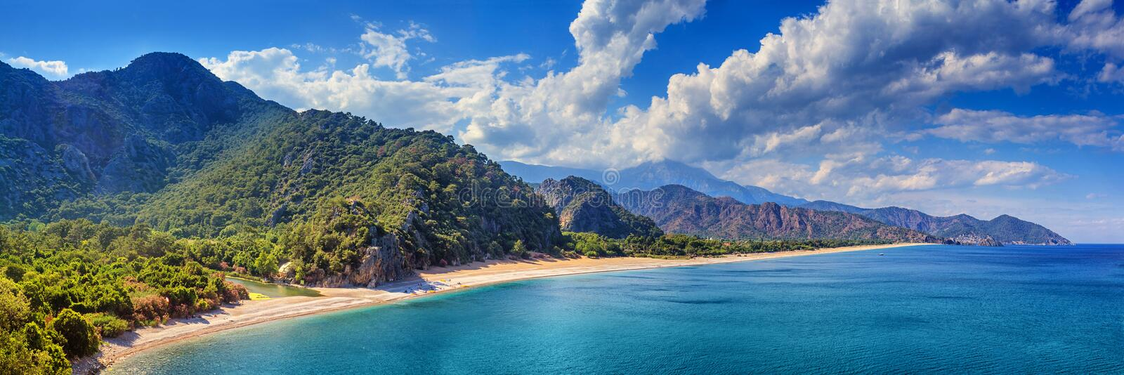 Summer mediterranean coastal landscape - view of the Cirali Olympos Beach, near the Turkish village of Cıralı. Antalya Province in Turkey stock photography
