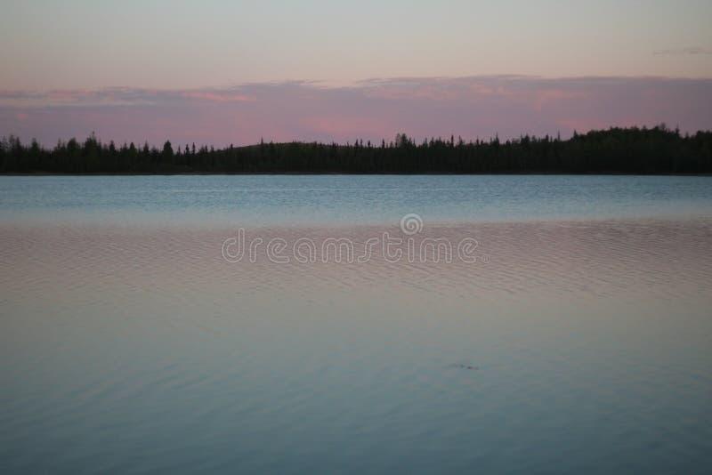 Summer midnight in Alaska stock images