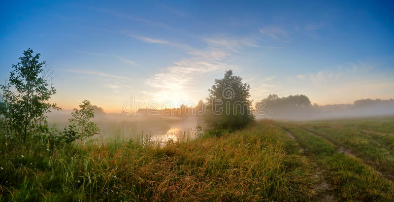 Download Summer Misty Sunrise On The River. Foggy River In The Morning. P Stock Photo - Image: 83712882