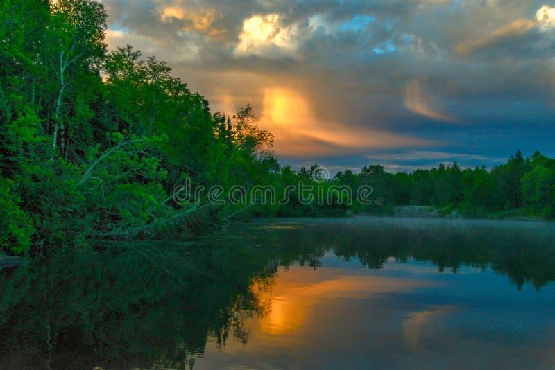 Summer morning on the lake. Lakeshore sunrise reflection on water. Shoreline horizontal photo stock photo