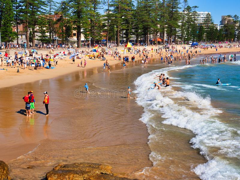 Summer Morning at Manly Beach, Sydney, Australia. A fine summer morning at the Pacific Ocean yellow sand Manly Beach, Sydney, NSW, Australia, with white capped stock photo