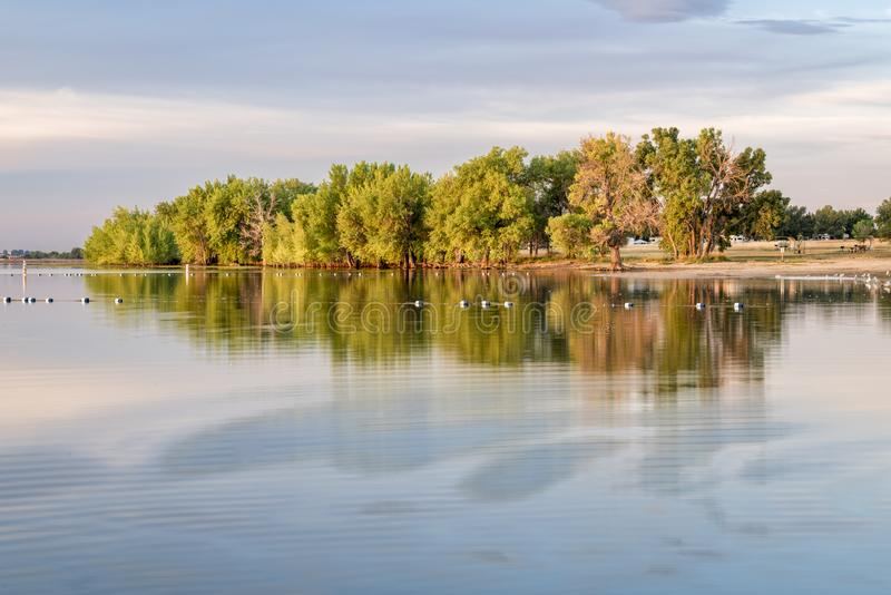 Summer morning on swimming beach. Summer morning in Boyd Lake State Park, Colorado with an empty swimming beach stock photo