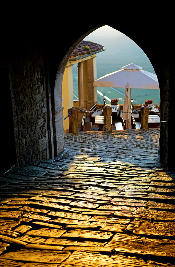 Summer in motovun. Summer in medieval town, arch entrance gate in the picturesque city of Motovun, Croatia stock image