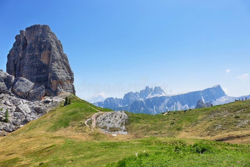 Summer mountain alpine meadow landscape. Cinque Torri, Dolomites, Italy stock photography