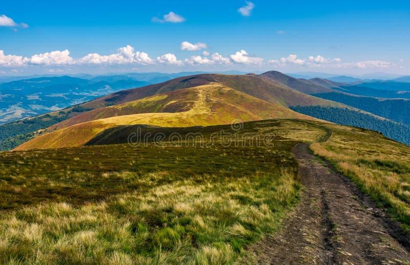 Footpath down the hill through mountain ridge stock photos