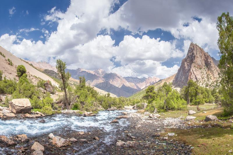 Summer mountains landscape. Mountain river in valley in Tajikistan. Beautiful view on scenery rocks and mountain nature stock photography