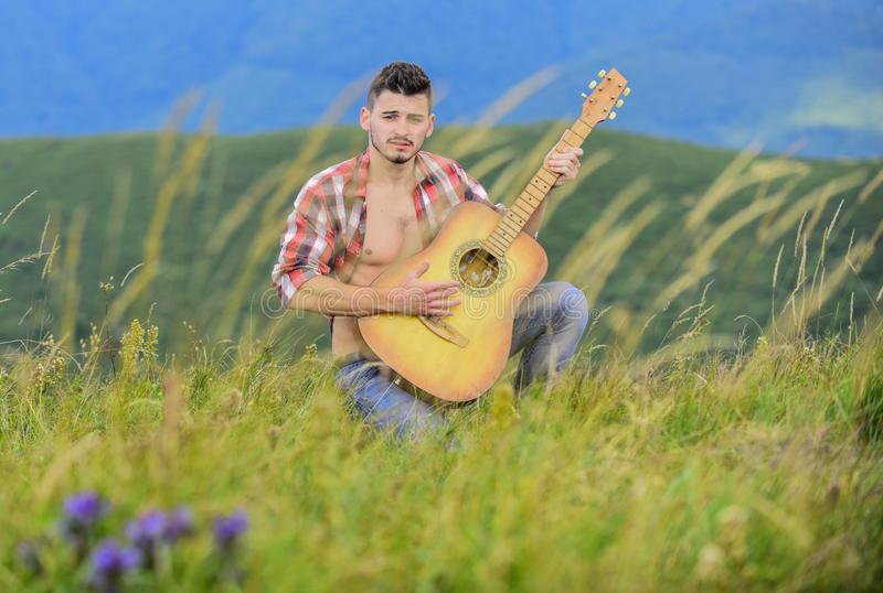 Summer music festival outdoors. Playing music. Sound of freedom. Inspired musician play rock ballad. Compose melody. Inspiring environment. Man with guitar on royalty free stock photos