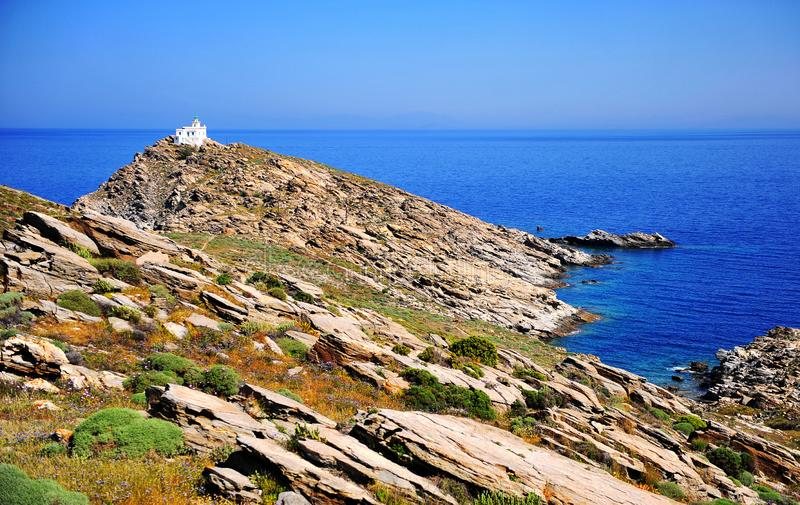 Summer natural landscape with white lighthouse on cape of Paros. Island, Greece royalty free stock photos