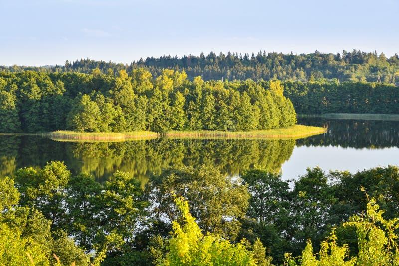 Summer nature landscape, lake. Scenic summer nature landscape, lake at Aukstadvaris regional park, Lithuania royalty free stock photography