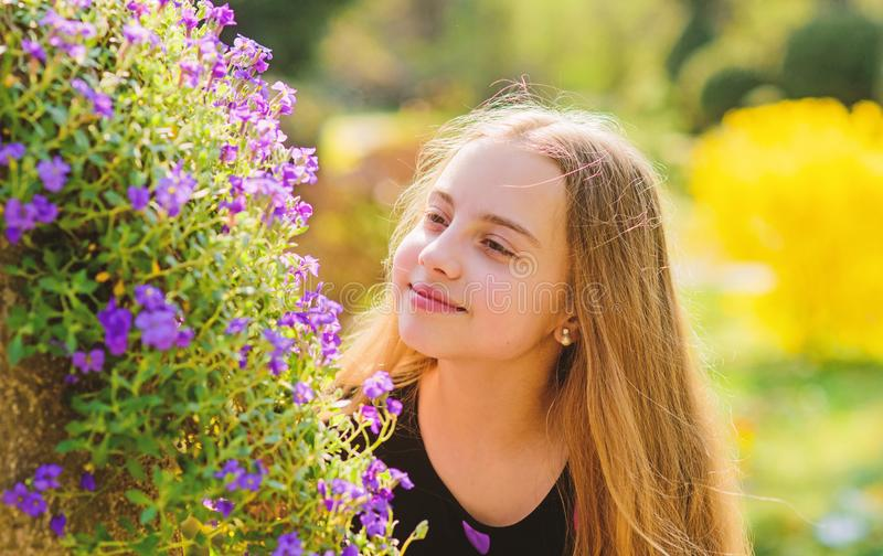 Summer nature. Natural beauty. Childhood happiness. little girl smell blooming flowers. Spring holiday. Womens day royalty free stock photo