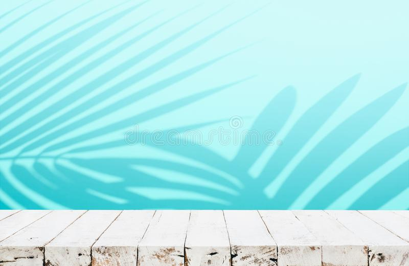 Summer and nature product display with wood table counter on blur coconut leaf background in blue color royalty free stock photos
