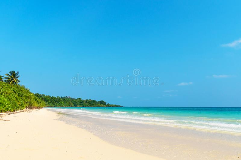 Summer nature scene. Tropical beach with sea, blue sky and palm trees,. Kood island is located in the South East part of Thailand. Beautiful sea and white sand stock photo