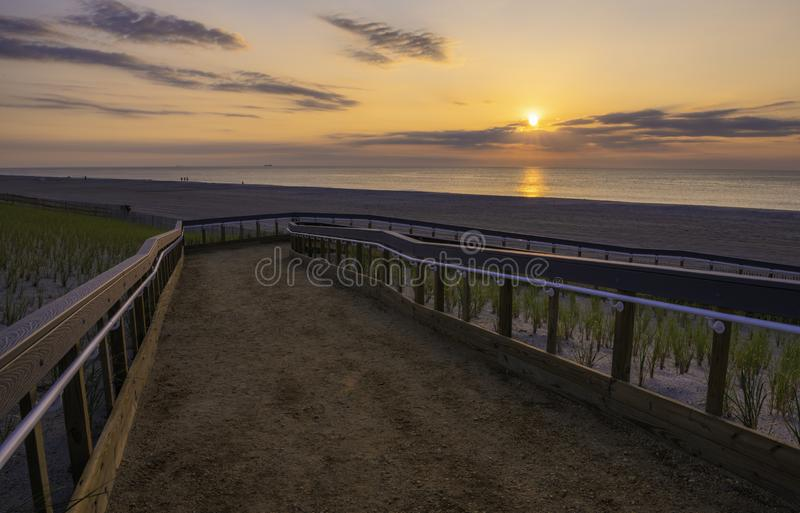 Summer in New Jersey Shore. Beautiful sunrise over Lavallette Beach, New Jersey featuring sand on the foreground and sunny sky on the background stock photo