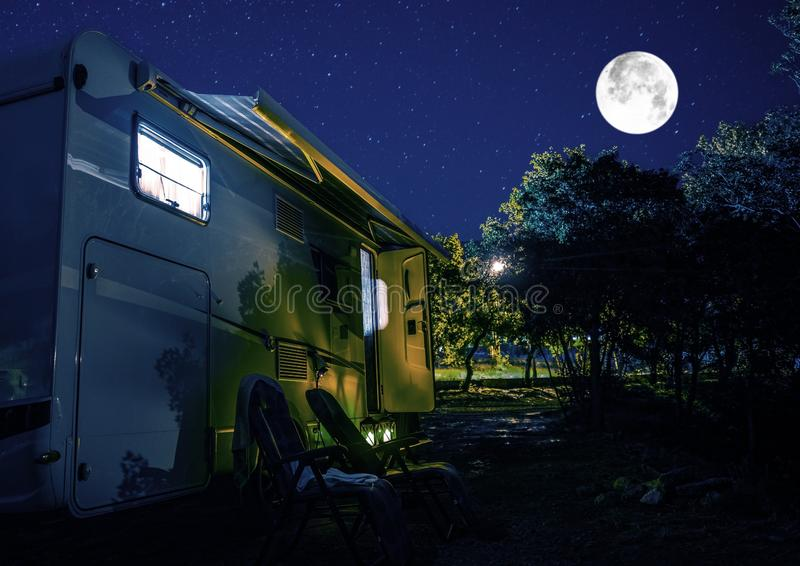 Summer Night RV Camping. Recreational Vehicle Class C Motorhome Under Starry Sky. Campground RV Park Pitch. Modern Camper Van stock image