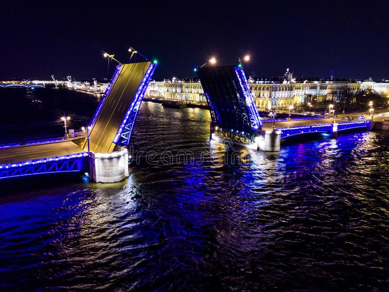 Summer night, Saint Petersburg, Russia. Neva River. Drawn bascule moveable Palace bridge. Winter Palace. stock photography