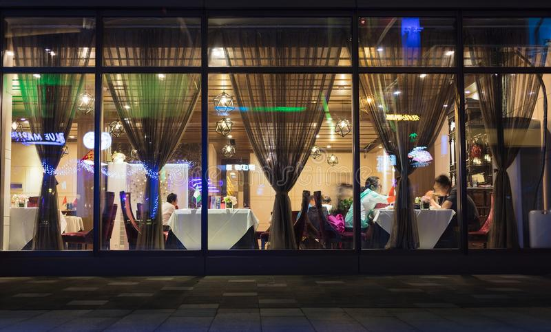 A restaurant on summer nights. On summer nights, people like to party in restaurants, drink beer, taste good food, enjoy air-conditioning, and make new friends royalty free stock photos