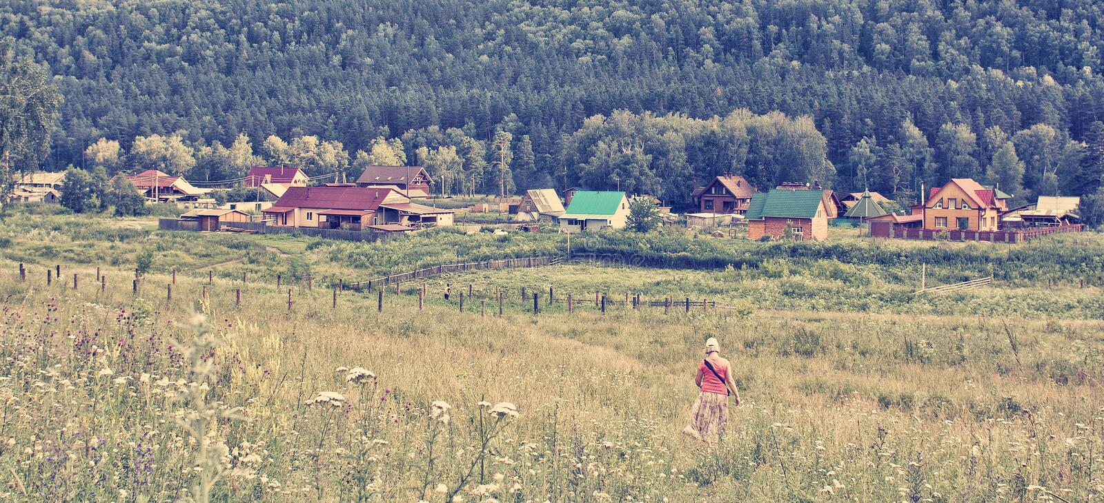 Summer noon in a mountain village. Gorny Altai, Russia stock photography