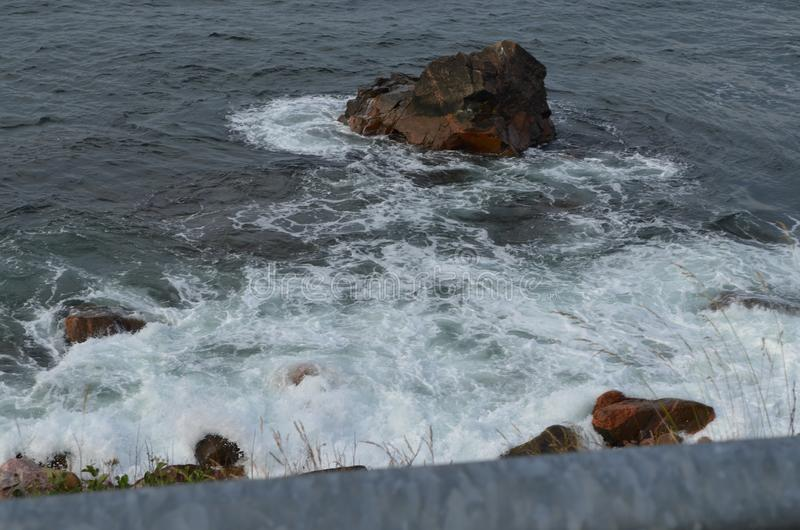 Summer in Nova Scotia: Surf From Broken Wave Along Rocky Shore Near Ingonish on Cape Breton Island stock photography