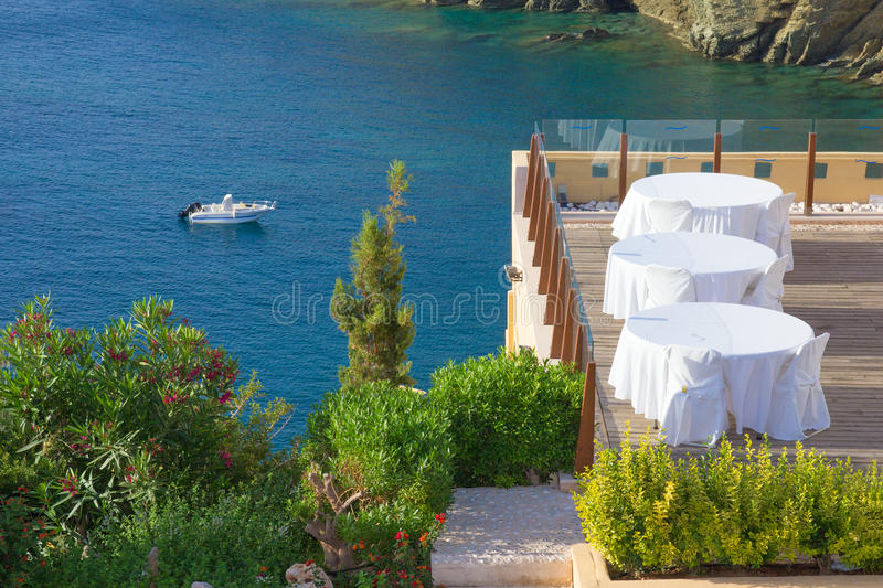 Summer outdoor restaurant terrace with sea view stock photo