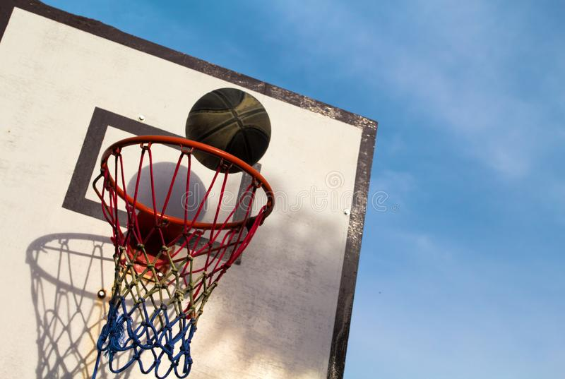 Summer outdoor sport game. Active lifestyle during school holiday. Elements of basketball sport. Ball and basket. Summer outdoor sport game. Active lifestyle stock photography