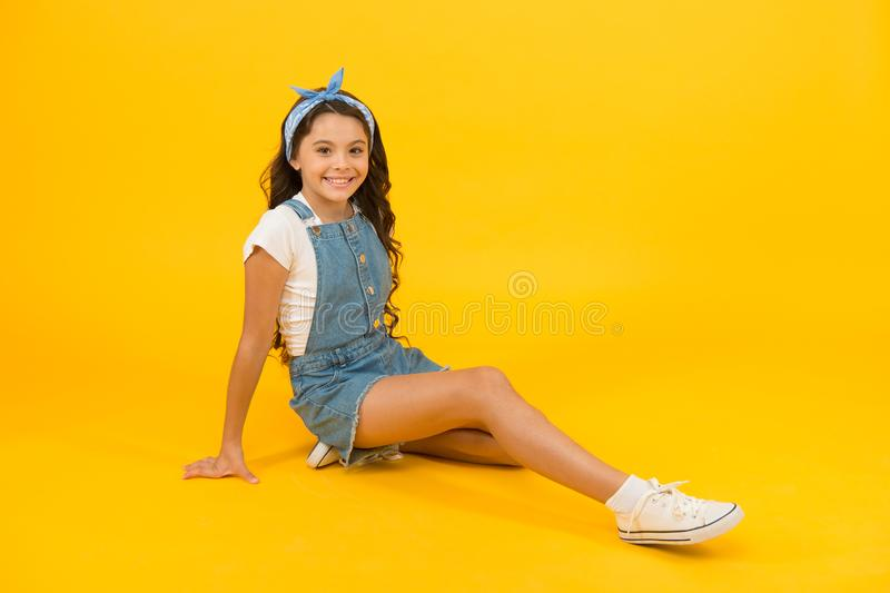 Summer outfit concept. Girl long curly hair sit relaxing. Fashion trend. Little fashionista. Carefree happy childhood royalty free stock photos