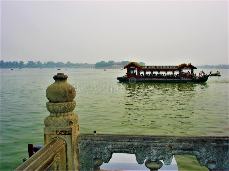 The Summer Palace lake in Beijing, China. Boat, water, balcony and traditional atmosphere stock images