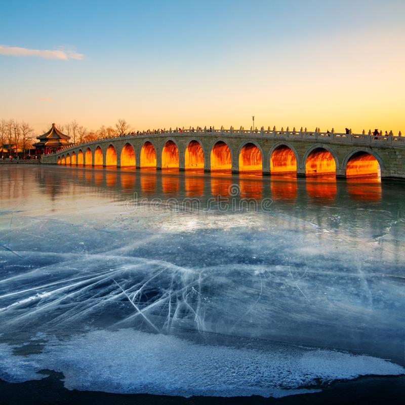 The Beijing Summer Palace, Winter Solstice, China. On the Winter Solstice and only on that day, the Sunshine will light up the entire 17 arches of the 17-Arch stock photos