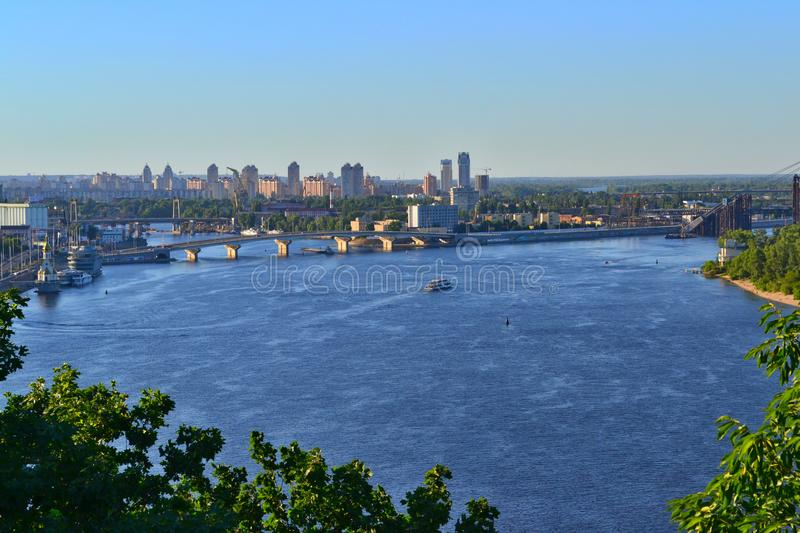 Summer panoramic view on the Dnieper River, Kyiv, Ukraine. Summer panoramic view on the Dnieper River and the Obolon District in Kyiv. There are high-rise stock image