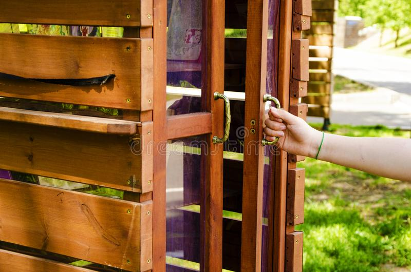In the summer park, a bookcase is available royalty free stock photos