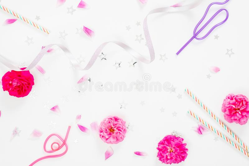 Summer party background with festive feminine accessories, ribbon, pink rose flower buds and petals on white background. Flat lay royalty free stock images